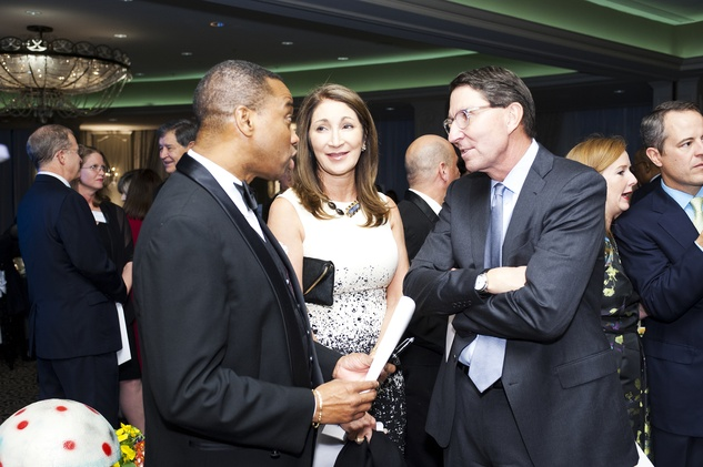 7493 Khambrel Marshall, from left, with Soraya and Scott McClelland at the Collaborative for Children dinner October 2014