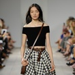 Michael Kors spring 2015 look 48 black sweater and gingham cotton skirt