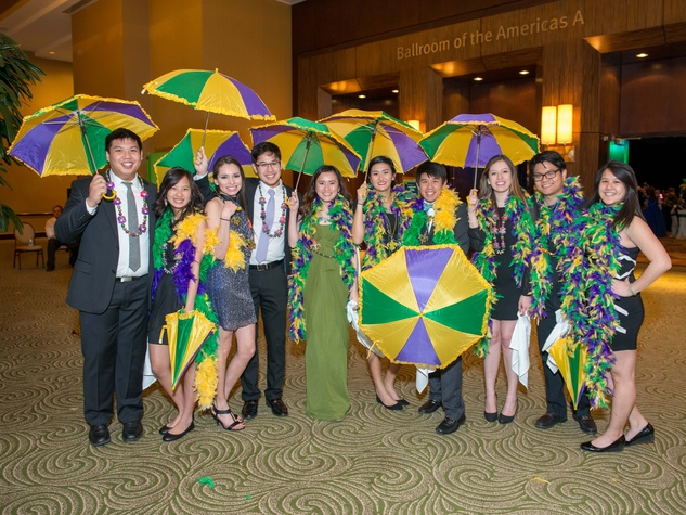 25 St. Thomas student volunteers at the St. Thomas Mardi Gras Gala February 2015
