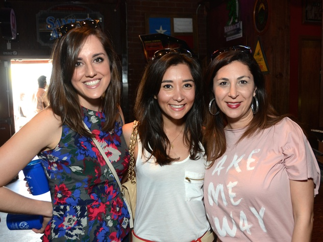 Megan Coody, from left, Hasti Taghi and  Debbie Elias at the Women of Wardrobe Spring Fling March 2014