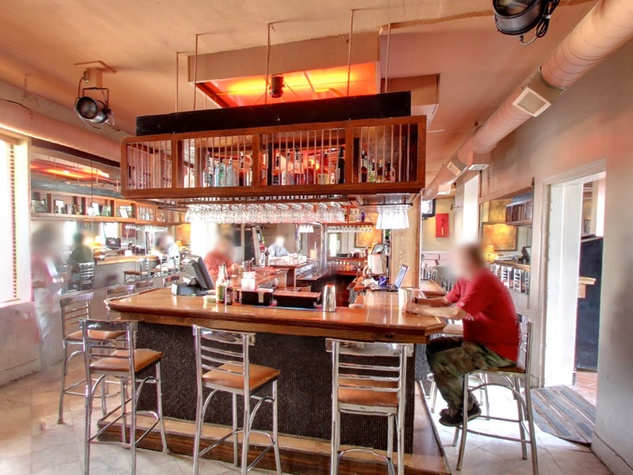 EJ's Bar Houston interior with people