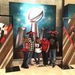 Super Bowl fans posing at Marriott Marquis hotel