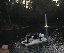 Steele party,Dalton Gray and Major Dodson are being given a boat ride across the Van Dykes pool by property manager Harold Robinson with other guests