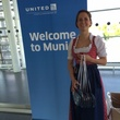 Woman greets travelers in Munich after inaugural United flight
