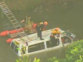 Van crashes into Bayou and all seven survive.
