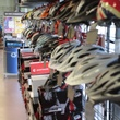 Helmets hang on the walls at Performance Bike