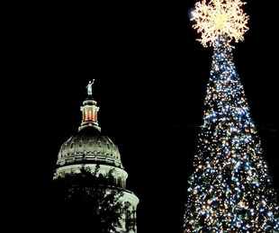 State Capitol and holiday Christmas tree lit up at night