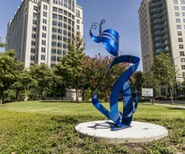 Uptown Dallas sculpture in park