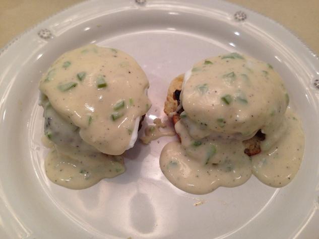 Siphon Coffee Houston eggs Benedict a la Cowboy biscuits, pan sausage, poached egg and secret jalapeño cream gravy