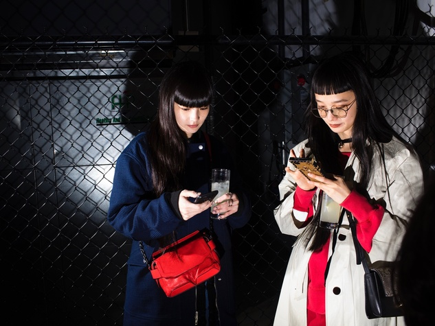 Rag & Bone party guests texting