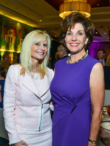 Jo Lynn Falgout, left, and Sherry Smith at the Memorial Hermann Razzle Dazzle Pink Luncheon October 2013