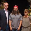 Gil Baumgarten, from left, Jep Robertson and Sue Baumgarten at the LifeHouse Houston Duck Dynasty dinner September 2014