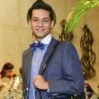 79 Neal Hamil model in Festari suit with men's bag for bid at Heroes and Handbags May 2014