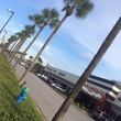 River Oaks Shopping Center with palm trees