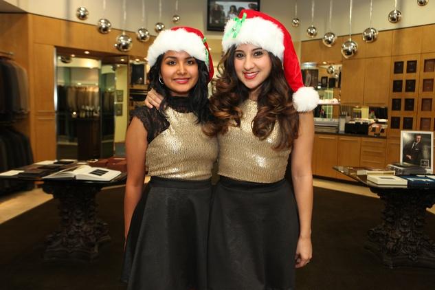 1615 Laura Michaca, left, and Natalie Guzman at the Festari for Men Christmas Party December 2013