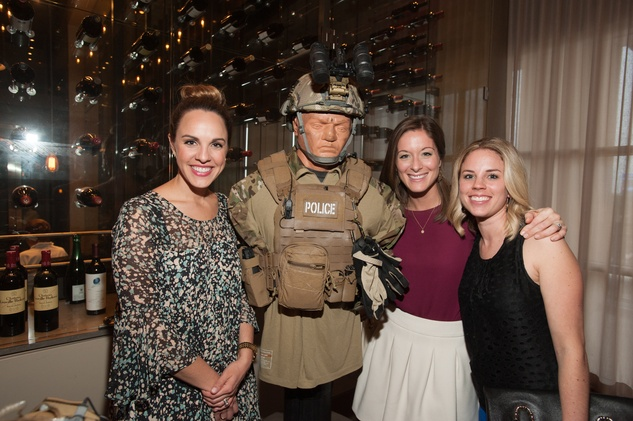 Angelina Shanklin, from left, Allie Hodges and Maggie Weathersby with police dummy at the Houston Police Department benefit April 2015