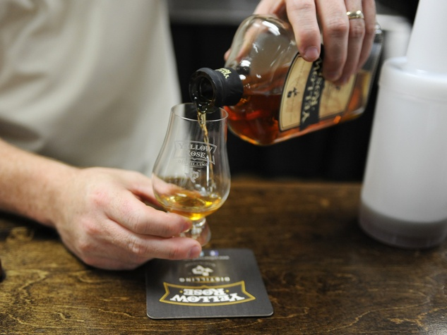 10 Yellow Rose Distilling September 2014 pouring a glass of whiskey