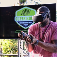 Arian Foster play virtual reality game at Avocado Bowl
