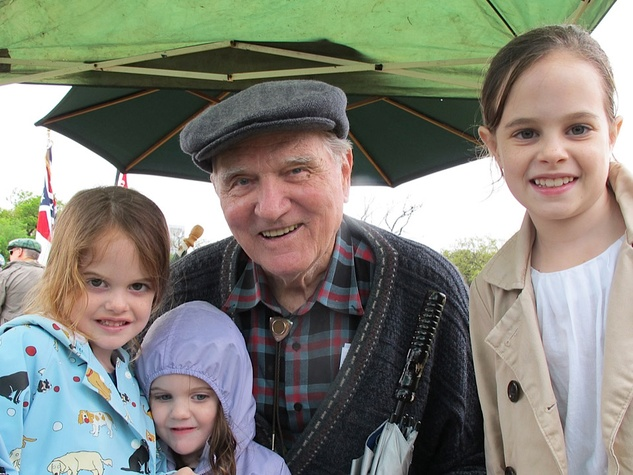 News_Katie_Dick Dowling Statute_cleaning_March 2012_Lucy Miggins, Claire Miggins, Larry Miggins and Molly Miggins. _Larry is Father of 12, Grandfather of 35)
