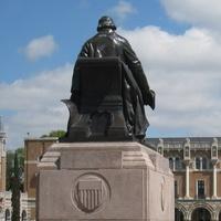 News_Rice_University_-_Rice_statue_with_Lovett_Hall