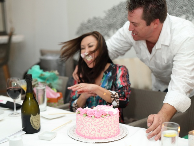 Lily Jang and Kevin Bryant engagement with cake and champagne December 2014