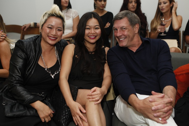 Sydney Dao, from left, Chloe Dao and Neal Hamil at the David Peck runway show September 2014