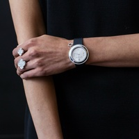 Woman's arm with watch