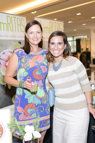 47 Lisa Pounds, left, and Thais Amaral Tellawi at the WOW Summer Soiree August 2014