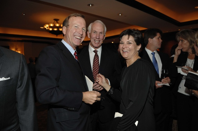 Neil Bush, from left, with R.C. and Nel Slocum at the George Bush Presidential Library Foundation dinner December 2013
