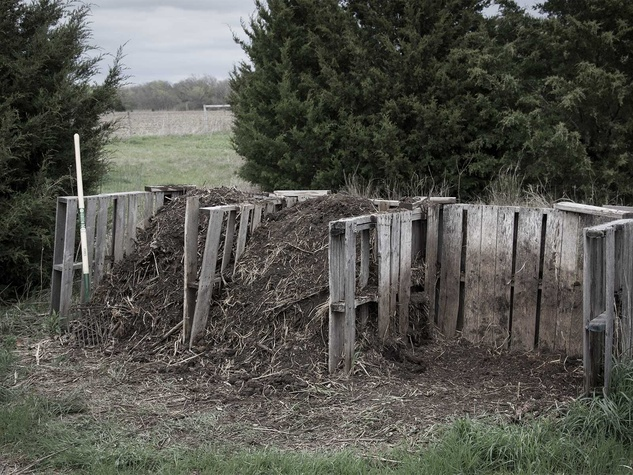 A three-bay compost bin built from upcycled pallets.