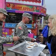 News, Shelby, Carrie Carr serves chili, Rodeo Armed Services Day, March 2014