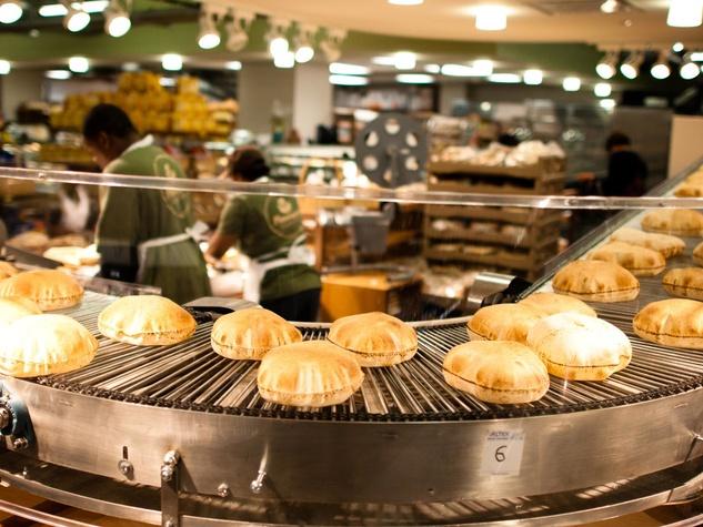 Phoenicia Specialty Foods bread pita bread on conveyor belt
