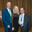 21 Tracy and Laurie Krohn, from left, with Franco Vallobra at the Crime Stoppers Gala November 2014