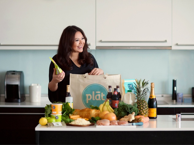 Woman with groceries delivered by Plat
