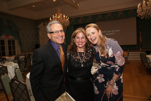 29 Rick Wester, from left, Libbie Masterson and Bevin Dubrowski at the Houston Center for Photography Print Auction February 2014