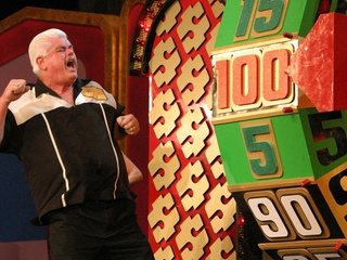 contestant on Price is Right Live winning on the big wheel during Showcase Showdown
