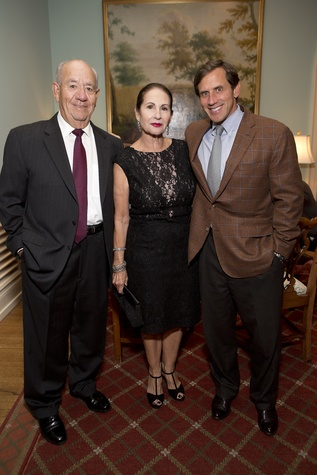 384 Rigo and Sally Flores, from left, with Greg Holloway at the Living Bank Gala October 2014