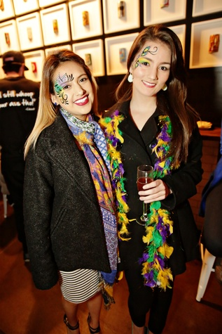 3 Wendy Perez, left, and Holly Fairdosi at Gray's Public House Mardi Gras grand opening benefiting Urban Green February 2015