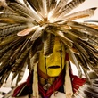 Man in ceremonial headdress and attire for Austin Powwow and American Indian Festival