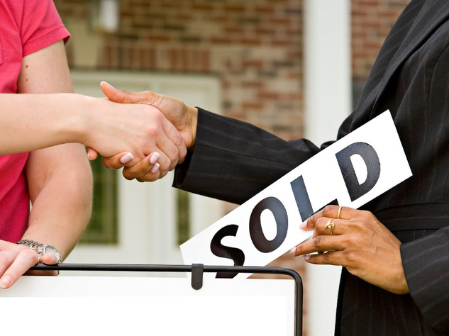 house sole sign with two people shaking hands