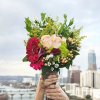 UrbanStems flower delivery service bouquet Austin skyline