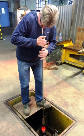 Cherri Carbonara Baccarat factory tour April 2015 Baccarat artisan blowing glass into a mold mounted in the floor