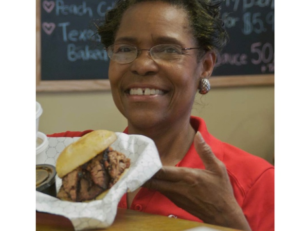 Gatlin's BBQ lady with barbecue