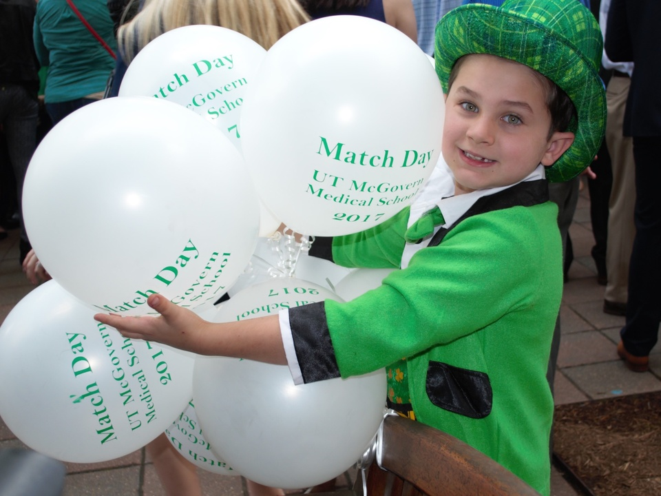 Ben Johnson with balloons at Match Day at UTHealth McGovern Medical School