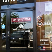 Front doors of bombay bistro located at the arboretum in austin, tx.