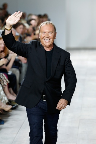 Michael Kors on the runway after showing of his spring collection