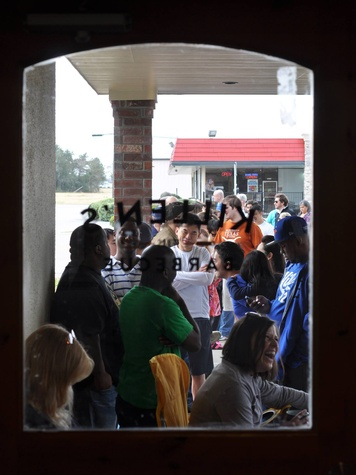 Killen's BBQ line outside door pre-opening February 2014