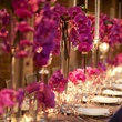 dinner table with flower arrangements, place settings at the Asprey dinner October 2013