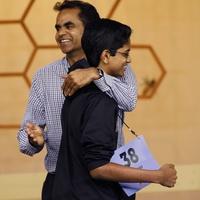 Houston Public Media Spelling Bee winner Shourav Dasari congratulated by his father