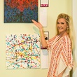 Melissa Poe Carson with her painting, art for the heart auction